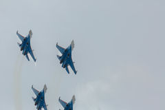 Fighter Sukhoi Su-27 show aerobatics at an airshow Russian Knights. Royalty Free Stock Photo