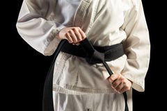 Fighter tightening karate belt stock photo