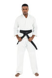 Fighter tightening karate belt Stock Images