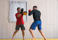 Fighter training his MMA skills Stock Photography