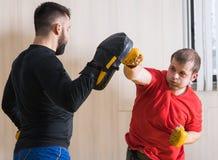 Fighter training his MMA skills Stock Photo