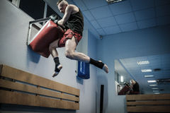 Fighter training with punching pad at gym Royalty Free Stock Image