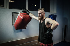 Fighter training with punching pad at gym Stock Photo