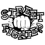 Fighter. Vector illustration fist on grunge background. Inscription street fighter. For tattoo or t-shirt design Stock Images