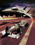 Fighter versus race car. A fighter F15 flies low close to a formula one race car Royalty Free Stock Photo