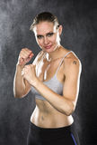 Fighter Woman Smiles at Camera Against Water Drops royalty free stock photos