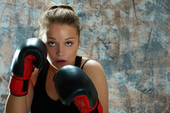 Fighter woman wearing boxing gloves Royalty Free Stock Image