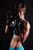 Fighter woman wearing boxing gloves Stock Photos