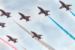 Fighters carry out aerobatic maneuvers. Nine fighters carry out aerobatic maneuvers. Joint flight of group with a turn and the subsequent evolution Royalty Free Stock Images