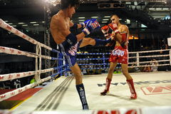 Muaythai World Championships. Fighters compete in a match in the Muaythai World Championships at the Thai National Stadium on March 21, 2013 in Bangkok, Thailand Royalty Free Stock Photos