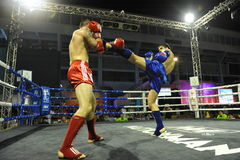 Muaythai World Championships. Fighters compete in a match in the Muaythai World Championships at the Thai National Stadium on March 21, 2013 in Bangkok, Thailand royalty free stock photo
