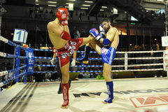 Muaythai World Championships. Fighters compete in a match in the Muaythai World Championships at the Thai National Stadium on March 21, 2013 in Bangkok, Thailand royalty free stock image