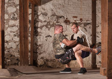 Fighters Doing Guard Situps. Mixed martial artists practicing guard sit ups Royalty Free Stock Images