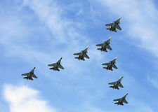 Fighters in flight. Group of russian fighters flying in a blue sky Stock Photo