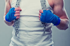 Fighters hands. Ready for fight with the chain in both hands and around neck Royalty Free Stock Image