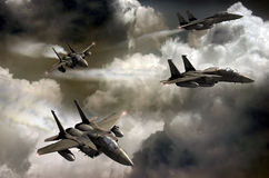 Fighters patrol. Five F15 fighters in training over the clouds Royalty Free Stock Photography