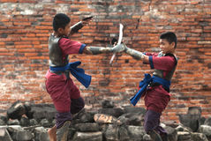 Fighters take part in an outdoor ancient Thai fencing. Stock Image