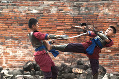 Fighters take part in an outdoor ancient Thai fencing. Stock Photography