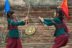 Fighters take part in an outdoor ancient Thai fencing. Royalty Free Stock Photo