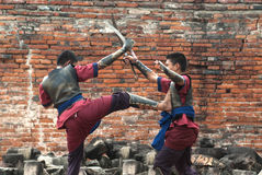 Fighters take part in an outdoor ancient Thai fencing. Stock Photo