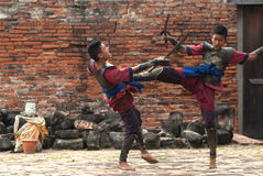 Fighters take part in an outdoor ancient Thai fencing. Royalty Free Stock Images