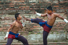 Fighters take part in an outdoor Muay Boran. Stock Photography