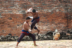 Fighters take part in an outdoor Muay Boran. Stock Image