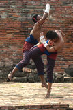 Fighters take part in an outdoor Muay Boran. Stock Images