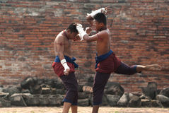 Fighters take part in an outdoor Muay Boran. Stock Photos