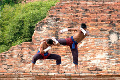 Fighters take part in an outdoor Muay Boran. AYUTTHAYA,THAILAND-MAR 26 : Two boxer that showed how to use the Muay Thai Boran in  Wai Kru Muay thai Ceremony and Stock Image