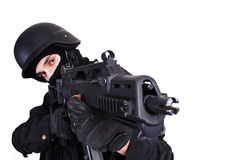 Fighting. Shot of a soldier holding gun. Uniform conforms to special services(soldiers) of the NATO countries. Shot in studio. Isolated with clipping path Royalty Free Stock Photos