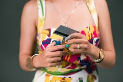 Fighting the addiction. Close-up of female hands cutting through her credit card Royalty Free Stock Images