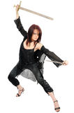 Fighting attractive assassin woman Stock Images