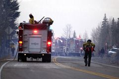 Fighting a blaze. Firefighters on the side of a road, forest fire royalty free stock photos