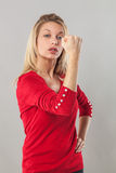 Fighting blond 20s woman with fist in the foreground Royalty Free Stock Photo