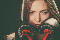 Woman cover face with boxing gloves. Fighting boxing and defense. Sportsmanship and strong body. Young woman wear sportswear and boxing gloves cover face look royalty free stock photography