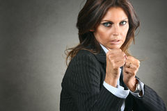 Fighting business woman Stock Image