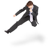 Fighting businessman kicked in jump on white. Fighting businessman kicked in the jump, isolated on a white background Stock Photography