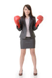 Fighting businesswoman with glove Royalty Free Stock Image