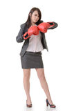 Fighting businesswoman with glove Royalty Free Stock Photos