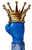 Fighting Champion. Business concept with a gold crown on a blue boxing glove belonging to a businessman representing the competition idea of a winning strategy Stock Photos