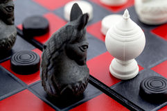 Fighting between chess board Stock Photos