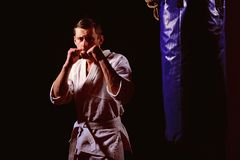 Fighting concept. Fighting man in kimono. Karate man in fighting stance. Keep fighting.  stock image