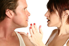 Fighting Couple. Attractive 35 year old couple fighting over white background. Motion blur on woman's hand Royalty Free Stock Photos