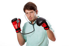 Fighting doctor on an examination Royalty Free Stock Image