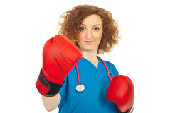 Fighting doctor woman with boxing gloves Stock Photo