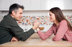 Fighting for dominance. Young couple fighting for relationship domination Stock Image