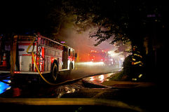 Fighting a Fire. Fire Trucks and Firefighters battle a blaze and try to do their job Stock Image