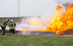 Fighting fire with a powder extinguisher. Szeged, Algyo, Hungary - October 8, 2015: Regional fire-fighting exercise in the training area with urban and contract Stock Photo