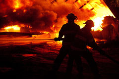Fighting fire Stock Photos
